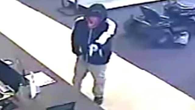 Surveillance image of Quick Cash Pawn armed robbery suspect