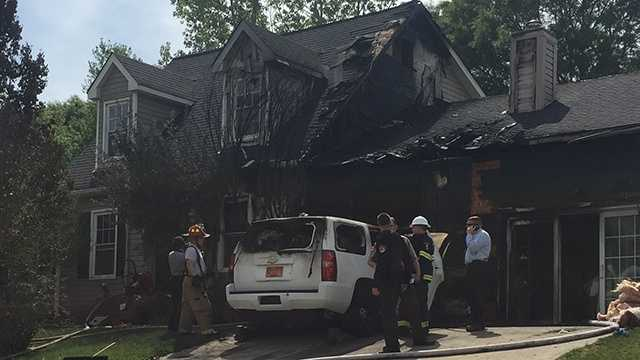 A vehicle fire spread to a Guilford County deputy's home Tuesday, High Point fire investigators said.