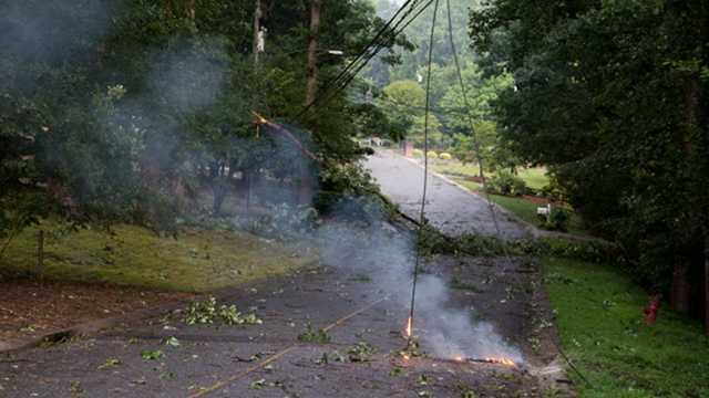Downed tree and live power line on Colonial Drive in North Wilkesboro. EMS officials recommend avoiding live power lines and calling the power company instead.