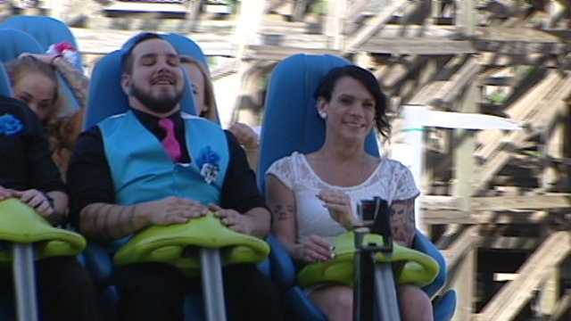James Music and Cortini Bryant of Mount Airy get married on the Fury 325 roller coaster at Carowinds amusement park.