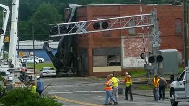 Winds blew a roof off a downtown Elkin building and fell near a car on Bridge Street.