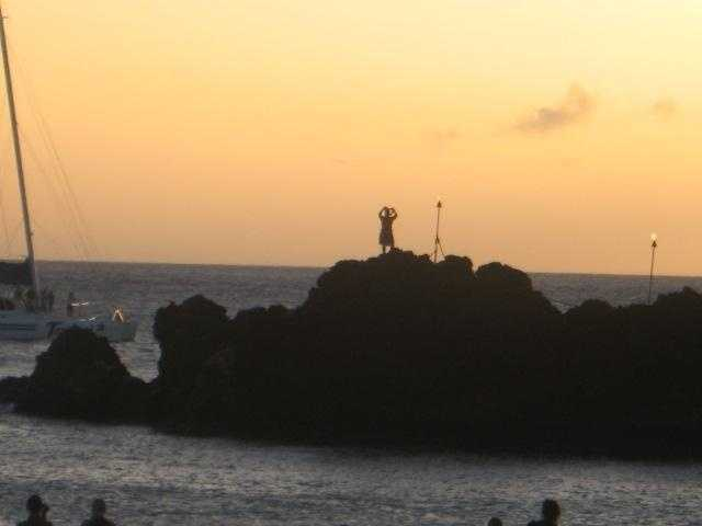 Luaus special shows have a tradition of a man jumping off a cliff and into the water at sunset.