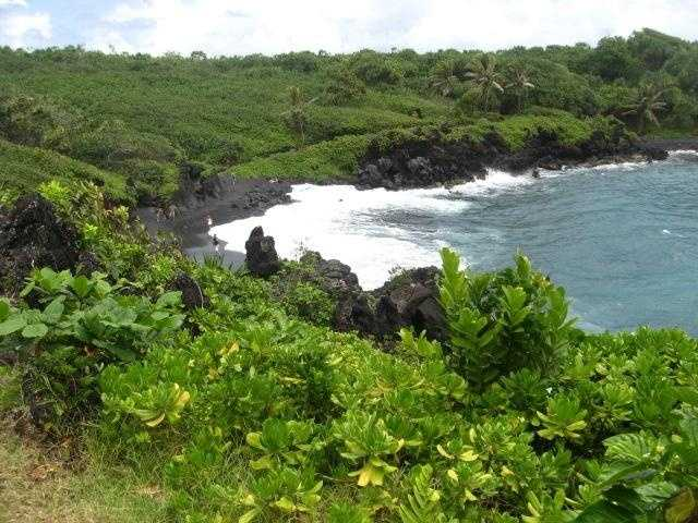 This area has a black lava sands on the beach.