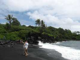 The black lava sand is soft and cool to visit and take honeymoon photos.
