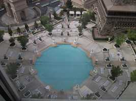 Paris Hotel and Casino has a beautiful pool area where the couple can get married under the Eiffel Tower. Or they can just take wedding photos by the pool.