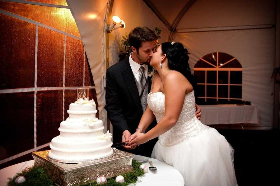 The couples cake table looks great with the grass look and baseballs around the table.