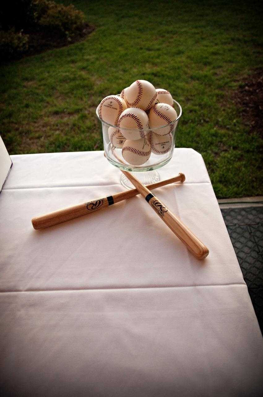 Simple things for any theme are spread around and can go along way in decorating like these baseball and bats.