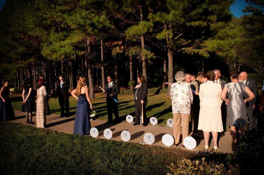 Cool baseball images with the teams logo line the entrance way for this theme wedding.