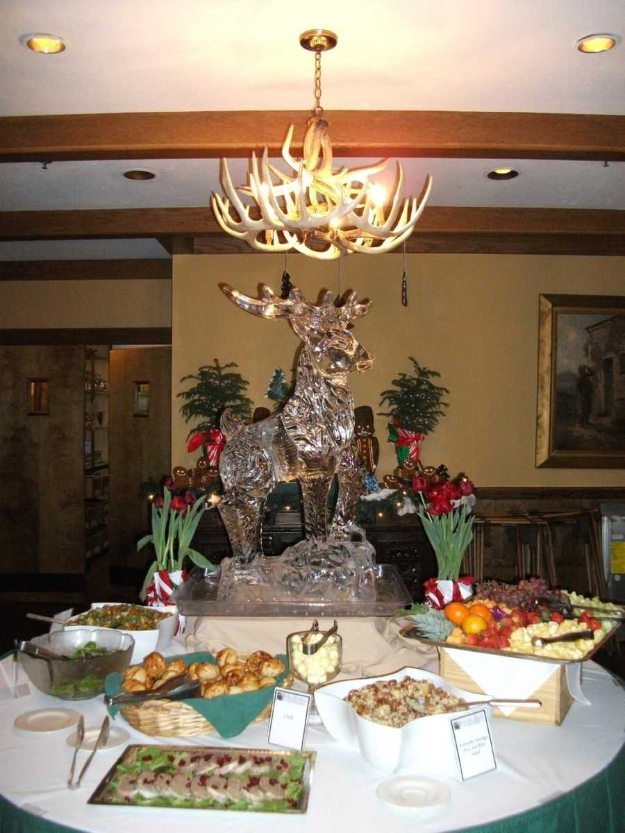 The ice sculptured deer works nice for the groom at the top of this reception food serving table. (Chetola Resort at Blowing Rock)