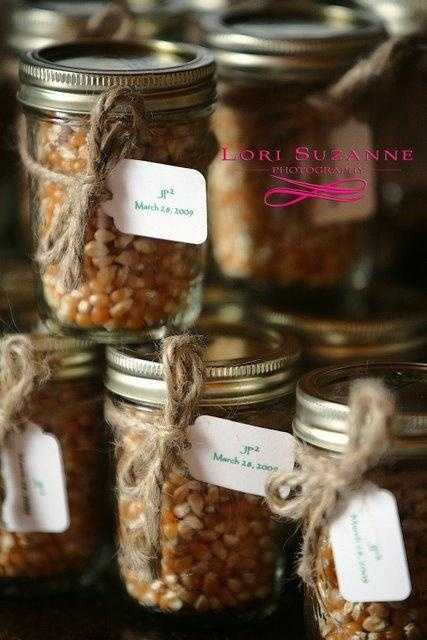 These mason jars with corn could be used as the wedding favors with names and the date. There are several items that could be used in these mason jars, like canned goodies. Also great seating name card idea.