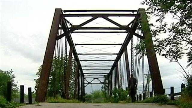 Community leaders are trying to get a railroad company to repair a closed bridge.