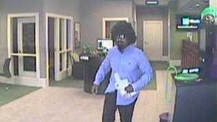 Robbery suspect in wig and goatee