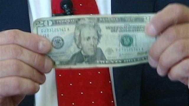 Surveillance video captures suspect passing fake money