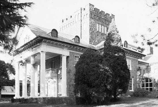 Isaqueena (The Gassaway Mansion), 106 DuPont Drive in Greenville, built between 1919 and 1924, was home of Walter Gassaway, a prominent member of Greenville's textile manufacturing industry. The mansion is said to have been designed by Minnie Quinn Gassaway after she took a correspondence course in architecture. The stones for the exterior of the house were gathered from a mill which had once belonged to Vardry McBee in downtown Greenville along the Reedy River.