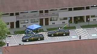 deputy shot at Red Roof Inn