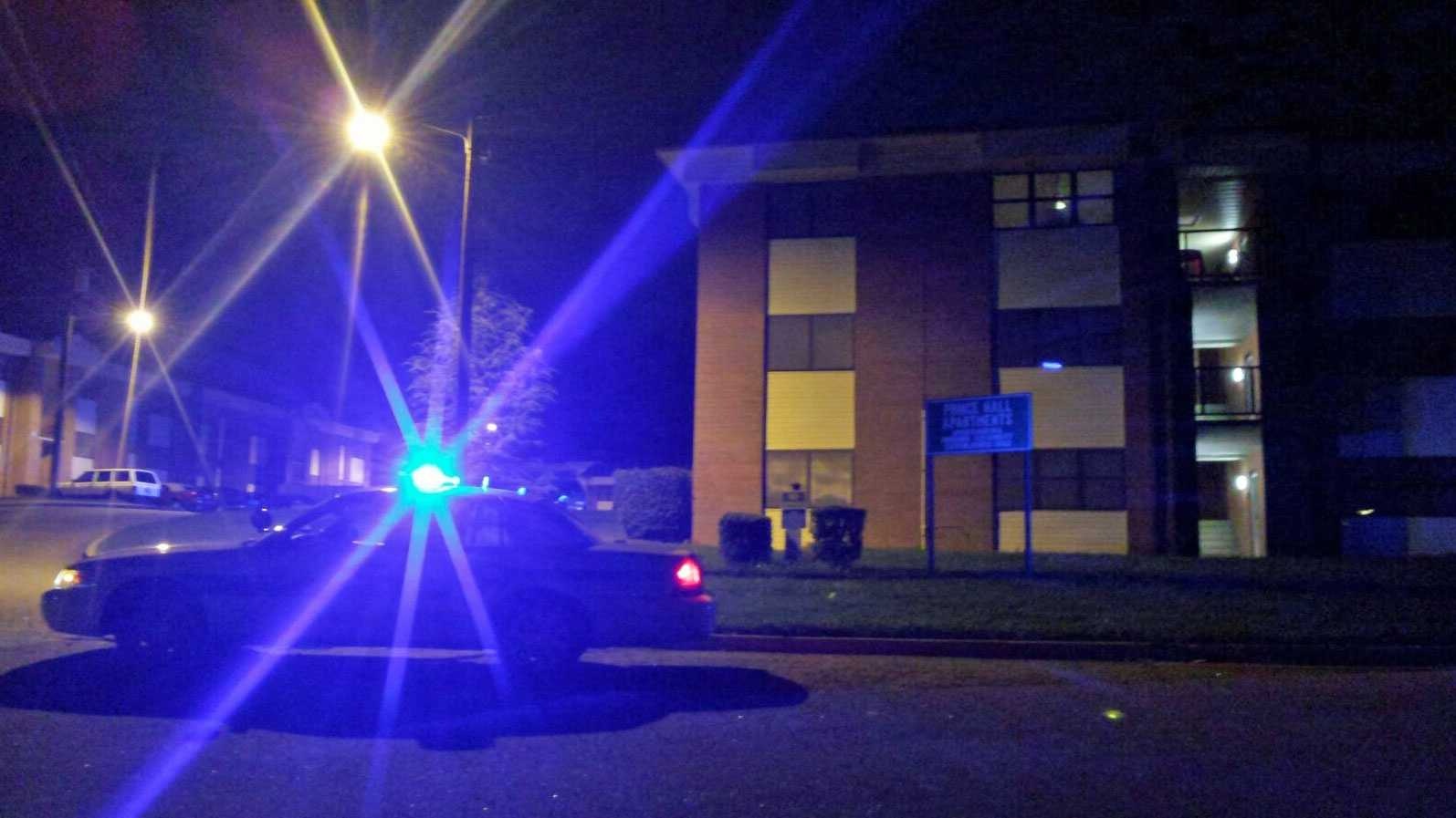 Police investigate the shooting on Prince Hall Lane early Monday.