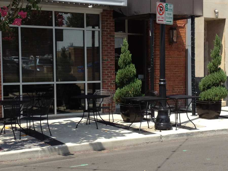 The plan also includes: outdoor seating, ornamental trees and a decorative fence.