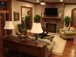 There are five fireplaces, nine old-world style oil-rubbed bronze chandeliers, sconces and other custom lighting fixtures.