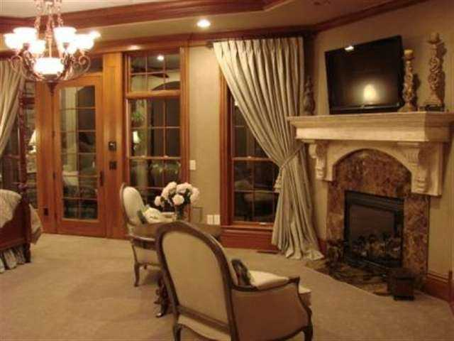 There is a 24-foot tall rotunda leading into the private entry foyer of the master suite that features a fireplace and private screened porch.