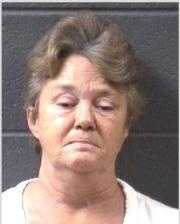 Judy McCurry: charged with 5 Counts of felony breaking/entering and larceny