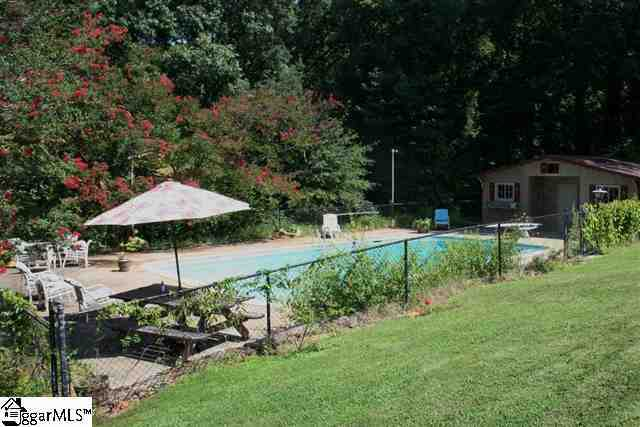 The estate features a salt water pool, a pond, a three-stall barn and multiple other outbuildings.