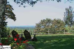 The property overlooks the valley below Paris Mountain.