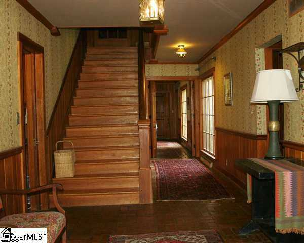 The home has hardwood floors and staircases.