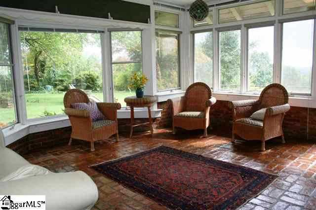Besides a sunroom, the home also has a rec Room, a media room, a workshop, a full finished basement and a 30'x20' great room.