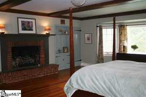 The master bedroom is 16x22 and features a full bath with a double sink and a dressing room with a walk-in closet.