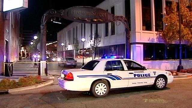 Conflicting reports emerge after an officer involved shooting in Downtown Greenville leaves one person dead.