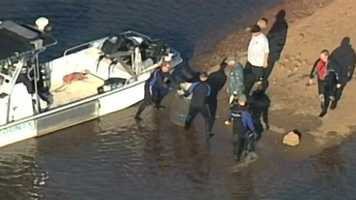 Divers carefully removed the barrels from the lake.