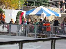 Anxious parents and children wait for the ice to be ready.