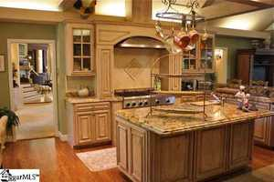 There is a 33' X 16' gourmet kitchen with an adjacent great room and dining room.