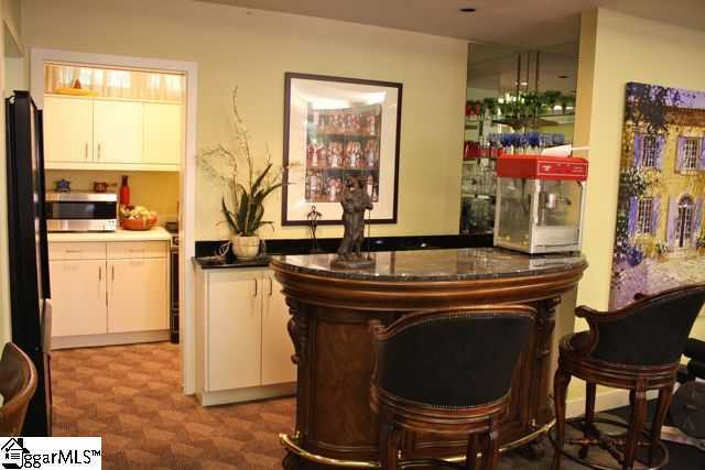 The lower level features a large recreational room with adjoining kitchenette, along with elegant guest quarters.