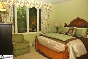 All five bedrooms have private baths and views of the surrounding landscape.