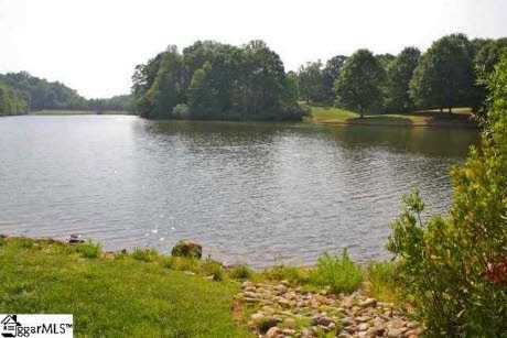 The home is on a peninsula in a lake, and the property is surrounded by water.