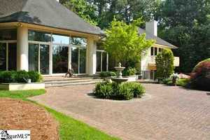 This country club home is located on nearly 3 acres in Spartanburg.