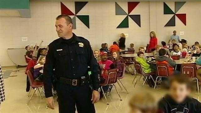 Armed deputies greet some Spartanburg elementary students at school