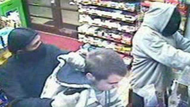One of the men held a gun to the employee's head and forced him into the store. He was forced to lie on the floor while, the other robber held a gun on the female clerk and took the cash from both registers.