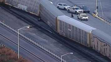 Several railroad cars jumped the tracks near the BMW plant in Spartanburg County early Friday.