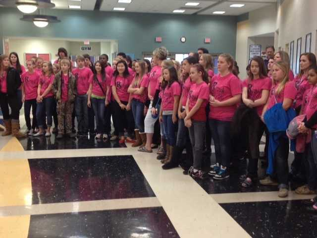 """Students and teachers wore pink shirts that said """"Royals Get Your Pink On"""" in honor of breast cancer awareness."""