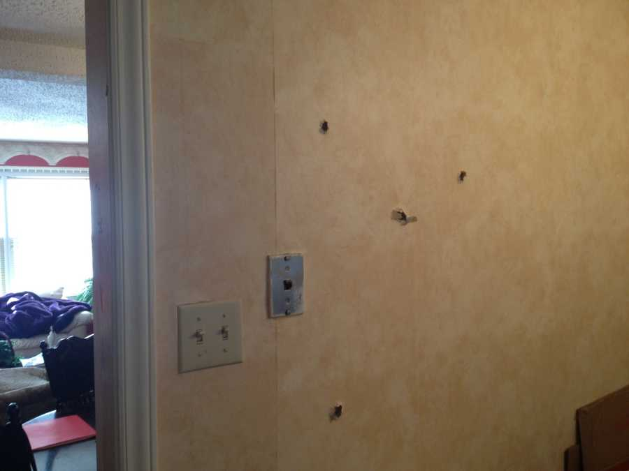 Several bullets went through the wall.