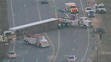 An 18-wheeler overturned early Friday morning in Spartanburg County, forcing drivers to find another route to work, according to South Carolina Highway Patrol troopers.