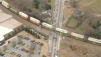 The train was fully loaded with piggybacked tractor-trailer cargo containers.