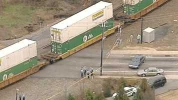 Police said the woman was trying to cross the tracks near downtown.