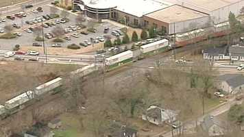Public Safety said the woman was able to avoid being hit by an eastbound train, but was then hit by a westbound train.