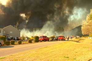 Firefighters and forestry officials fight a massive brush fire near Myrtle Beach. FULL STORY
