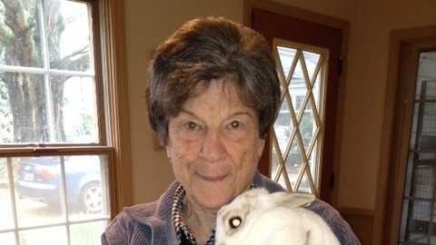 Caroline Gilbert, founder of Rabbit Sanctuary, Inc., holds rescued rabbit.
