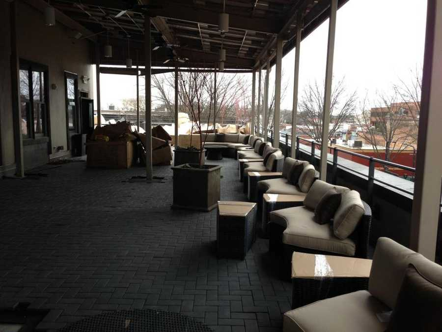 Sip, a Napa-style wine tasting room and rooftop lounge, will open April 11. Here are some of the seating units, ready to be moved into place.