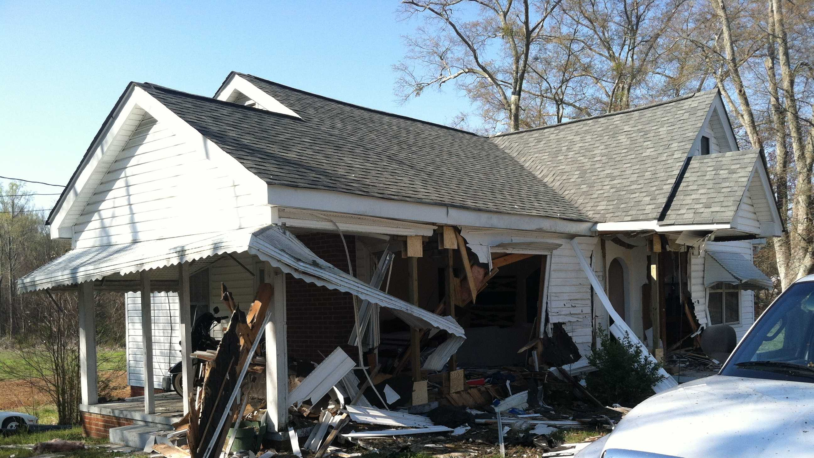 A car crash leaves part of home in shambles
